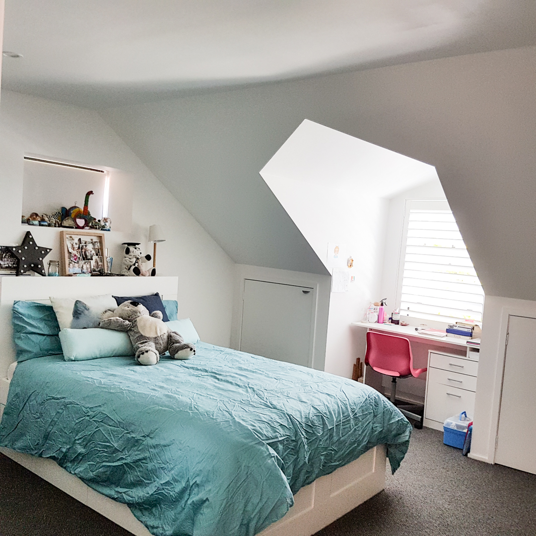 Attic conversion to bedroom with desk under Velux Skylight