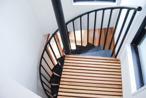 Curved metal staircase view from attic