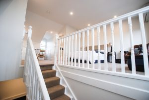 Attic staircase with white banister - view up to habitable attic room
