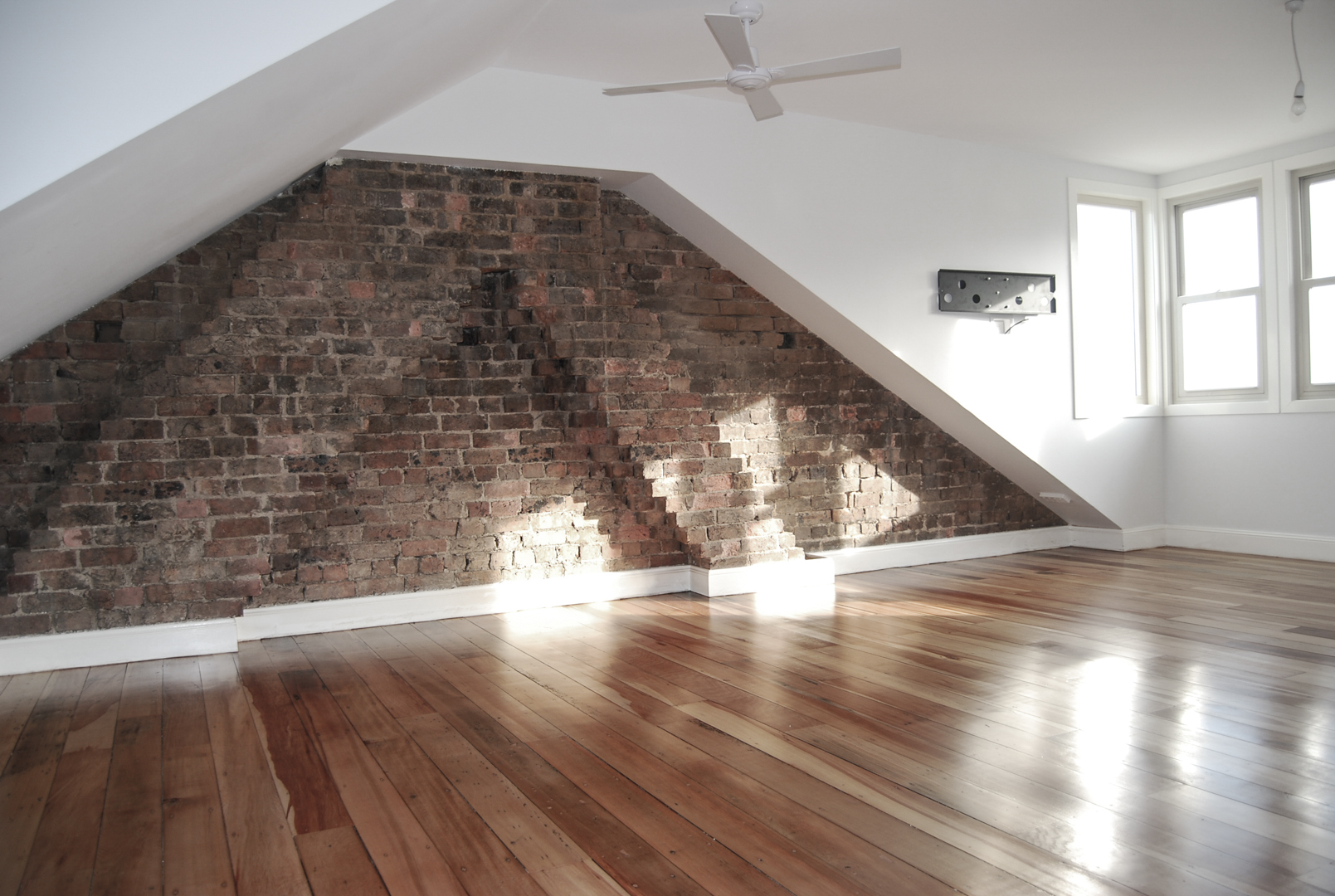Existing brickwork combined with new walls in attic conversion