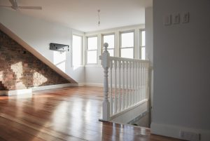 Well lit attic conversion with white banister, lighting and power