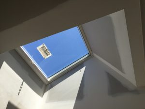 View of blue sky through skylight